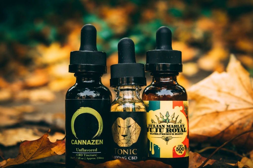 CBD Oil in several bottles. It's really good for treating most types of pain.