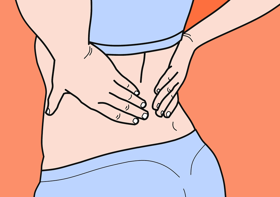 A woman rubs her lower back to show she's feeling pain